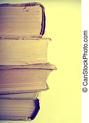 Stack of old books, vintage toned image. Copyspace on right.
