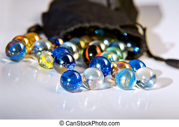 Colorful Marbles - Closeup on many colorful glass marbles on...