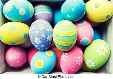 close up of colored easter eggs - easter, holidays,...