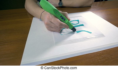 Technology of the future. 3D pen making products with plastic.