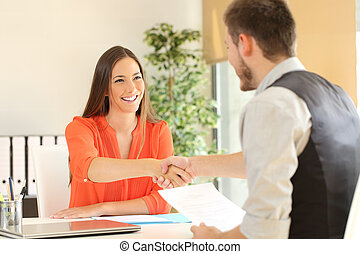 Employee and boss handshaking after a job interview