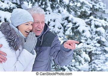 happy father with daughter, smiling and posing outdoors in...