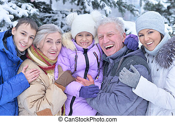 happy family portrait, smiling and posing outdoors in winter