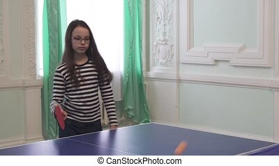Beautiful young girl plays table tennis stock footage video...