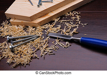 Wood shavings and various construction tools. Collage.