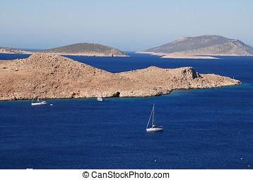 Emborio harbour, Halki - Sailing boats head into Emborio...