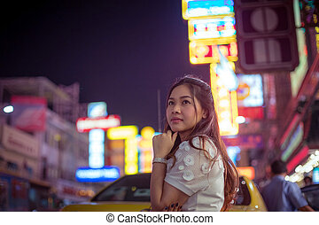 Portrait of asian woman, outdoor in night.