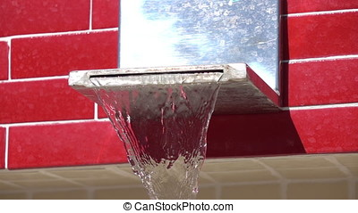 Two videos of water flowing from the public tap in real slow...