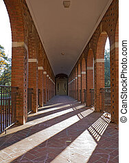 Arched walkway and morning sun vertical - Arched walkway on...
