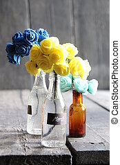 Merci tag and nice flowers in the bottles - nice flowers in...