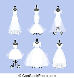 Set of Wedding Dresses. Fashion gowns on mannequins. White...