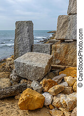 Cubic rocks - Pile of heavy cubic granite rocks by the...