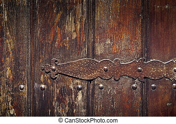 Old Hinge Detail - Detail of a rusty old iron hinge on a...