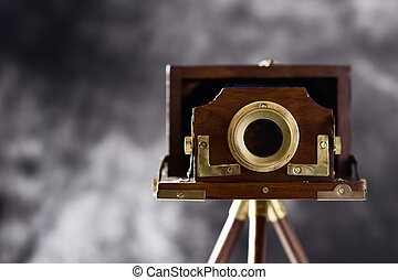 old folding camera - an old wooden folding camera in a...