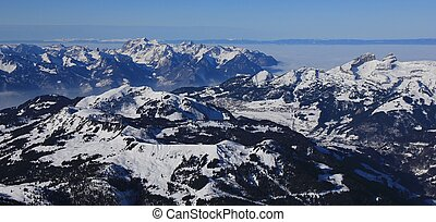 Distant view of Leysin and snow covered mountains - Winter...