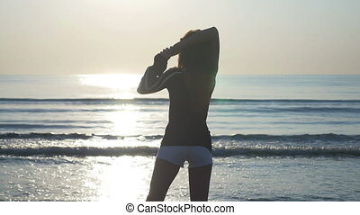 Woman doing stretching by the sea