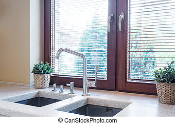 Kitchen tabletop with two sinks - Kitchen window close to...