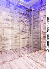 Glass shower stall in marble bathroom - Transparent glass...
