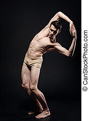 Gifted young ballet dancer performing in the studio