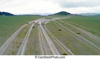 Four tourist jeep ride through the desert in Mongolia
