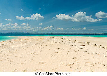 sandbank with transparent turquoise water and blue sky on...