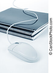 school textbook and computer mouse, online learning