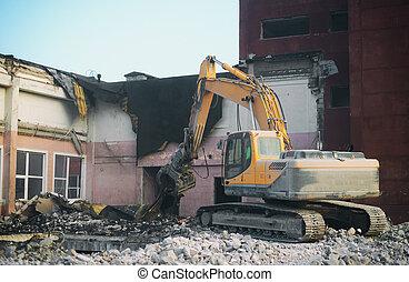 Hydraulic demolition crane dismantling school building.