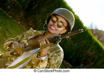 young girl african american with ww2 helmet and rifle -...