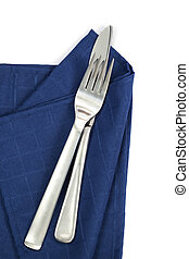 Knife and Fork on Napkin - Knife and fork on loosely folded...