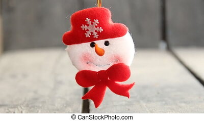 Winter concept. Snowman toy on a gray background.