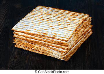 matzoh over wooden background - matzo flatbread for Jewish...