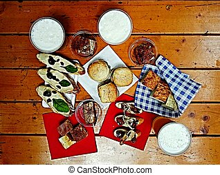 Finger food on a wooden table