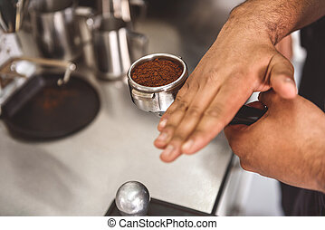 Way of making tasty coffee - Man evenly distributing...