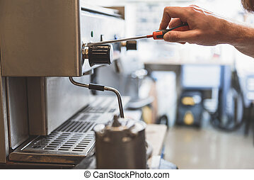 Man renovating fractured coffee-maker - Male person is using...