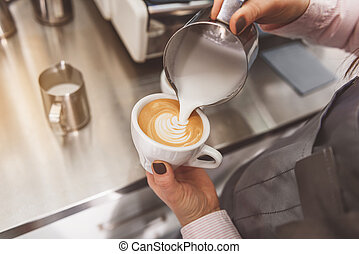 Woman filling cup of coffee - Female barista pouring shacked...