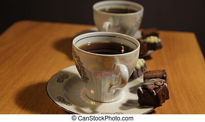 Tea set on the table with chocolate candy. - Chocolate...
