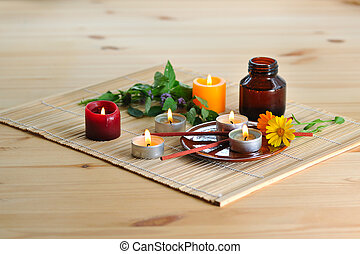 aromatherapy - scened burn candles with herbs and incense...