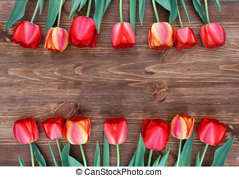 tulips on a natural wooden background - 14 tulips on a...