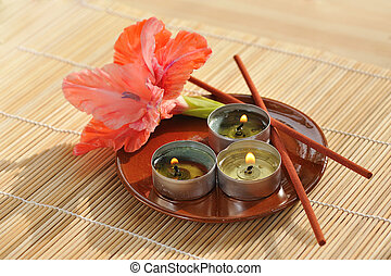 aromatherapy - scened burn candles with flower and incense...
