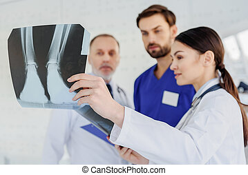 Skillful doctors analyzing x-ray photo - Smart medical team...