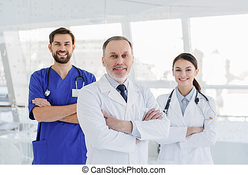 Cheerful medical team posing with confidence