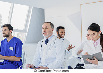 Joyful physicians are interested in new medicine notions -...