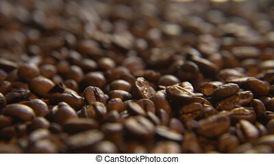 Roasted Coffee Beans, Left - Macro close up moving through...