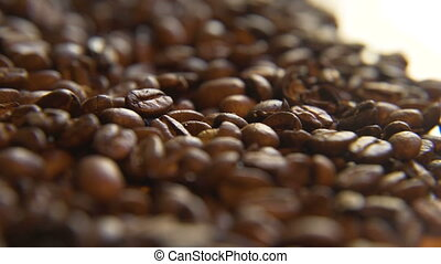 Across a Pile of Coffee Beans - Macro close up moving...