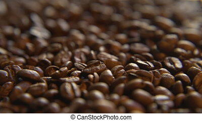 Roasted Coffee Beans, Right - Macro close up moving through...