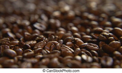 Down a Pile of Coffee Beans - Macro close up moving through...