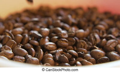 Coffee Beans Dropping - Macro close up of beans falling into...