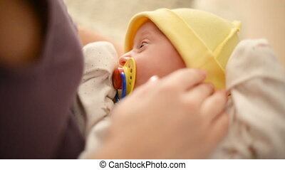 Mother caressing her newborn daughter. Holding little child