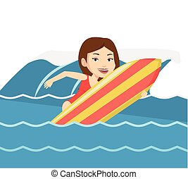 Happy surfer in action on a surf board.