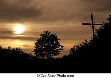 Wayside cross in the dusk and tree